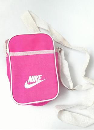 Женская барсетка через плечо розового цвета