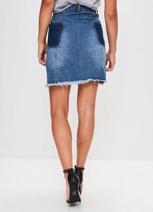 Стильная джинсовая юбка с котнрастными карманами3 фото