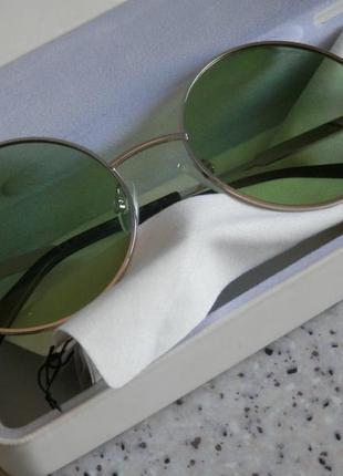 Круглые очки polaroid солнцезащитные
