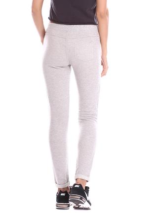 Спортивные брюки скинни с имитацией застежки и накладным карманом