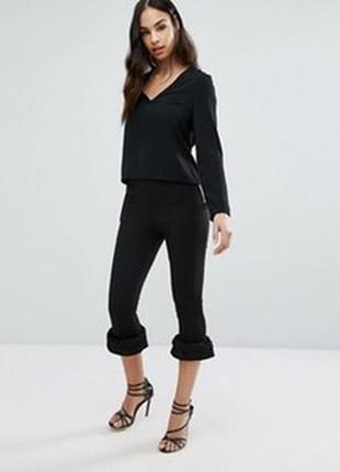 Трендовые брюки с воланами1 фото