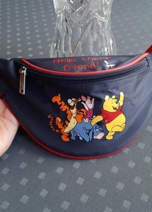 Красивая детская сумка бананка фирмы disney winnie the pooh
