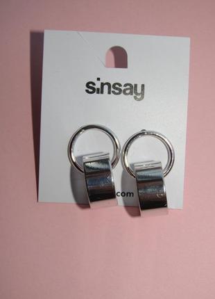 Серьги кольца серебряного цвета