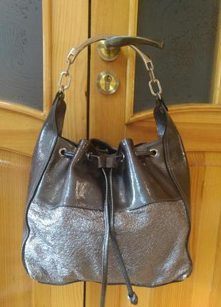 Красивая кожаная сумка мешок