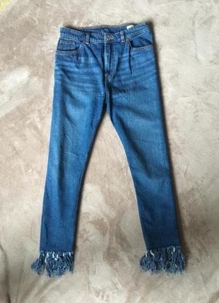 Винтажные джинсы с бахромой