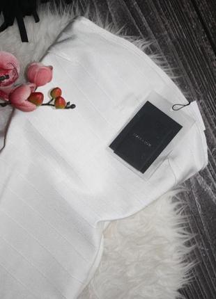Премиум коллецие бандажное молочное платье с бахромой3 фото