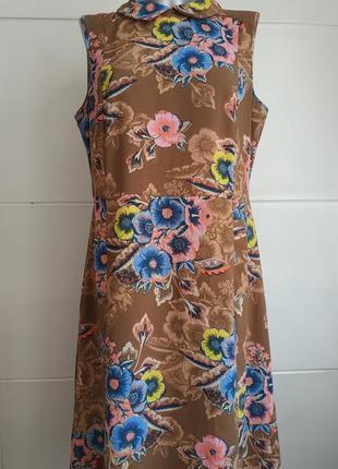 Стильное платье  next с принтом красивых цветов с боковыми карманами.