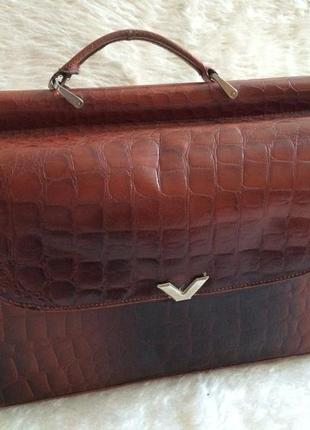 Рыжая кожаная сумка-портфель. отделения с двух сторон с несколькими внутренними карманами
