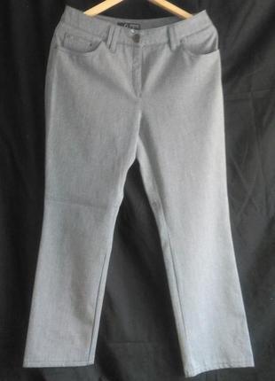 Хорошие  женские брюки на карманах со стразиками