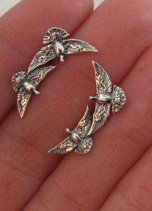 Серебряные каффы голуби