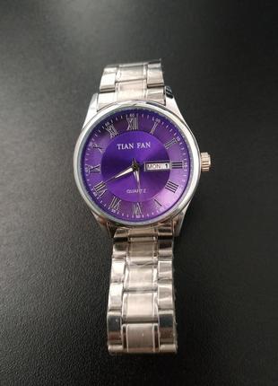Часы quartz tian fan