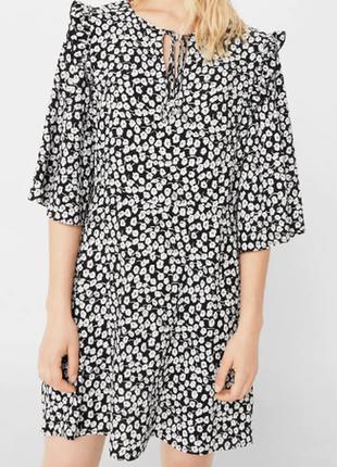 Расклешенное платье с рукавами
