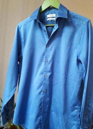 Котоновая рубашка в тонкую черно- синею полоску# calvin klein # оригинал