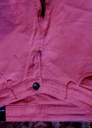Джинсы кораллово-оранжевого цвета.5