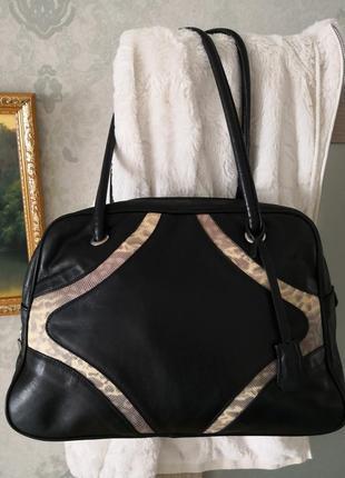 Элегантная брендовая кожаная сумка russel&bromley. италия.