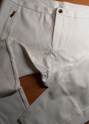 Белые брюки 54размер
