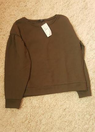 Шырокий свитер с приспущеными рукавами kiabi