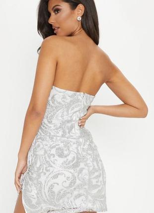 Роскошное мини платье бандо с бахромой и вырезами5 фото