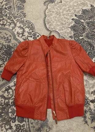 Кожаная куртка с коротким рукавом