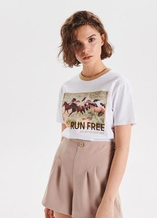 Продам новую женскую летннюю футболку