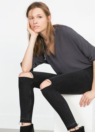 Узкие джинсы super skinny low ripped из стиранного элластичного денима с потёртостями