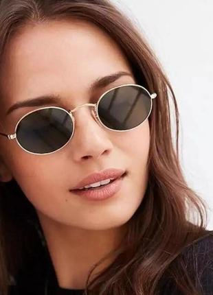 Очки солнцезащитные, трендовая овальная форма.