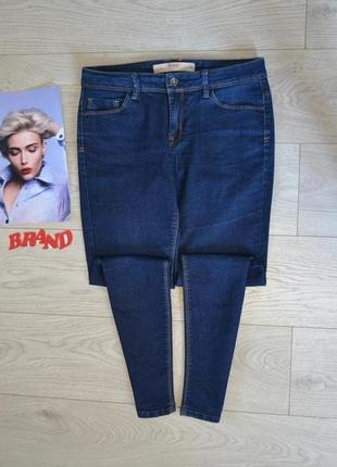 Стильные скинни джинсы средней посадкой