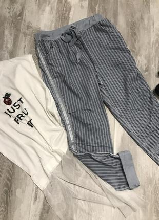 Стильные голубые котоновые штанишки .италия2 фото