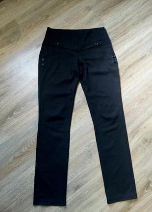 Классические брюки в мелкую полоску