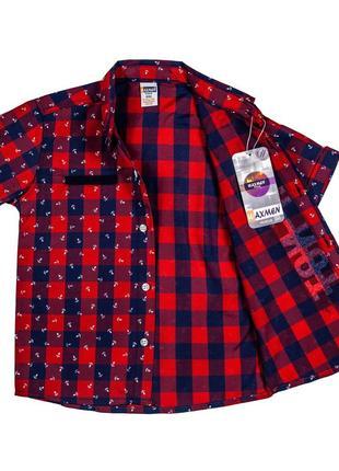 Клетчатая тениска с якорями на мальчика (размеры 6-9 лет)