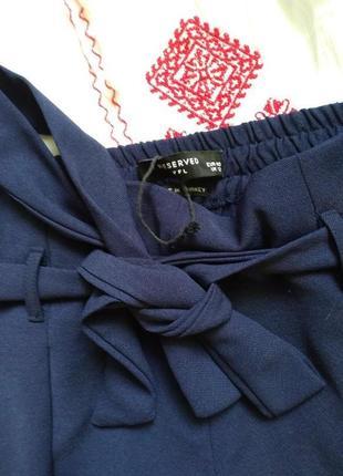 Актуальные брюки с поясом от reserved3 фото