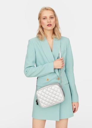 Новая серебристая  сумка кросс боди с ключиком