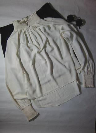Ніжна, елегантна блуза з подовженою спинкою і резинками на рукавах