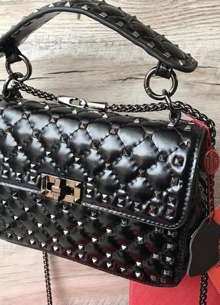 Женская кожаная сумка клатч с шипами заклепками