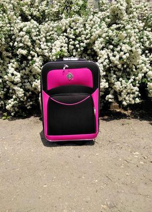 Дорожный чемодан польша средний на 8 колесах яркий цвет