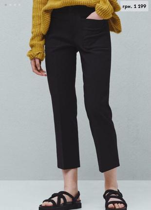 Чёрные брюки с карманами mango