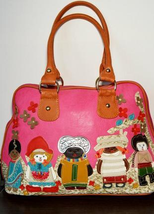 Стильная розовая сумка с аппликациями