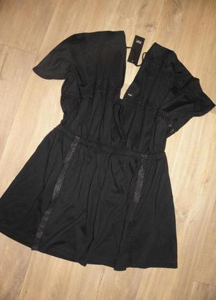 Красивое платье-туника с перфорацией