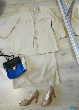 Фирменный элегантный женский юбочный костюм. юбка+ удлиненный жакет.