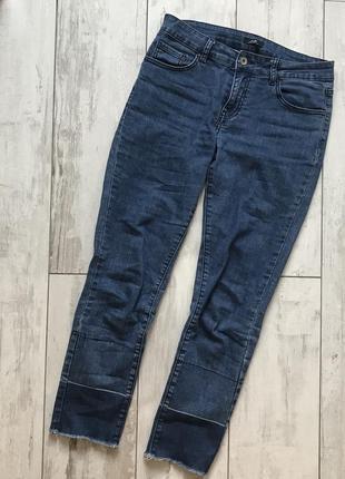 Стильні джинси з необробленим краєм