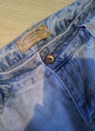 Брендовые джинсы рваный низ оригинал2 фото