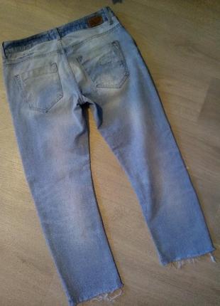 Брендовые джинсы рваный низ оригинал3 фото