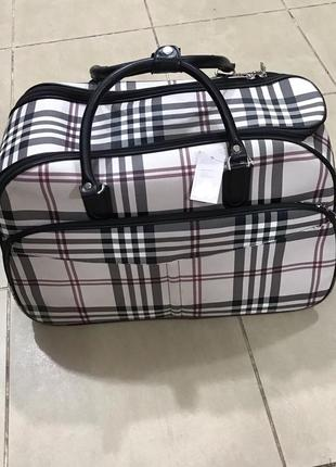 Новая дорожная сумка, чемодан на колесах в клетку черная, белая