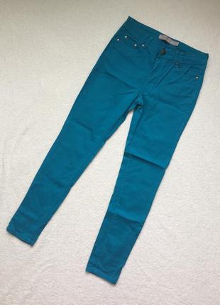 Бірюзові скінні джинси з високою талією