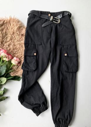 Тренд сезону, брюки з накладними карманами, брюки карго