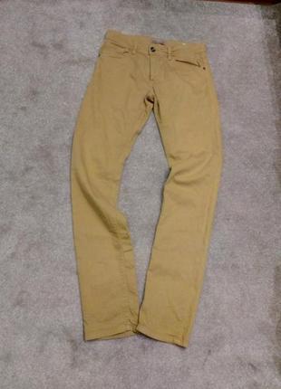 Яркие горчичные джинсы. celio. л        распродажа