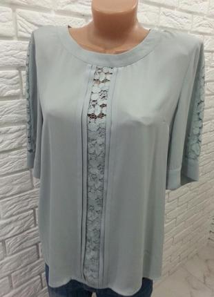 Дуже гарна блуза з кружевними вставками.