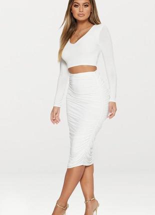 Нарядный, эффектный белый комплект кроп топ с длинными рукавами и юбка миди