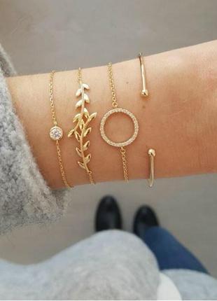 Набор браслетов золотистого цвета 4 штуки