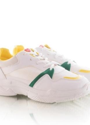 Белые кроссовки с желтыми вставками1 фото